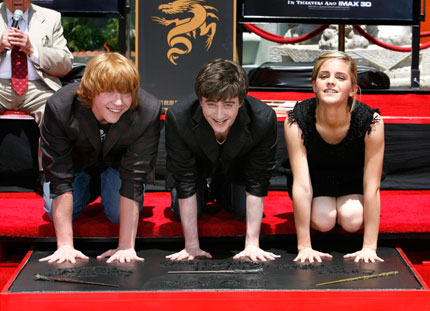 Cast members Daniel Radcliffe (C), Rupert Grint (L) and Emma Watson from the movie