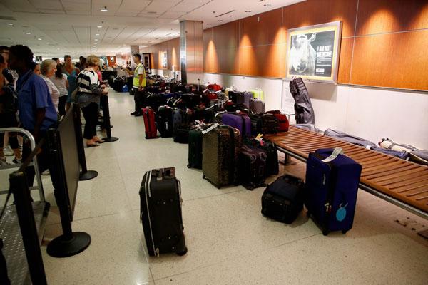 乘机出行Q&A:如何能更快取到行李?降落时为何打开遮光板?